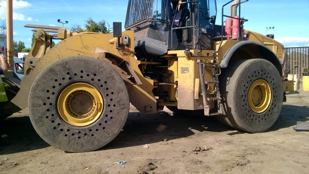 solid tyres on wheel loader; cushion solid tyres; air ride solid tyres; 29.5x25 solid tyres; CAT 980 solid tyres